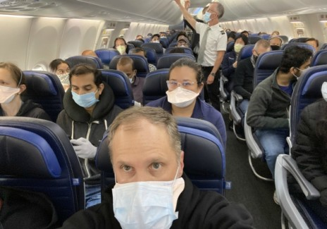 Dr. Weiss aboard a filled 737 flight from New York to San Francisco