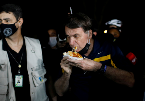 [VIDEO] Moment Brazil President was Jeered at and Called a 'Murder' as He Walked Up to Eat Hotdog Outside His Residence