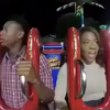 Couple on reverse bungee ride