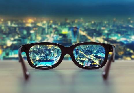 Night cityscape focused in glasses lenses