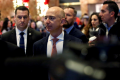 FILE PHOTO: Jeff Bezos, founder, chairman, and chief executive officer of Amazon.com enters Trump Tower ahead of a meeting of technology leaders with President-elect Donald Trump in Manhattan, New York City, U.S.